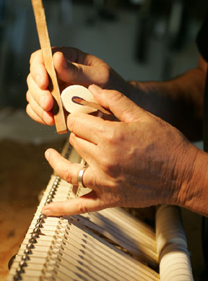 Tom Shaw fine tunes the action on a hammer for an 1897 Steinway piano. (The Daily Progress/Andrew Shurtleff)