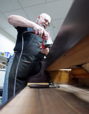 "Repairman Tom ""Kookie"" Kuck works on a 1913 Steinway M at the shop. (The Daily Progress/Andrew Shurtleff)"